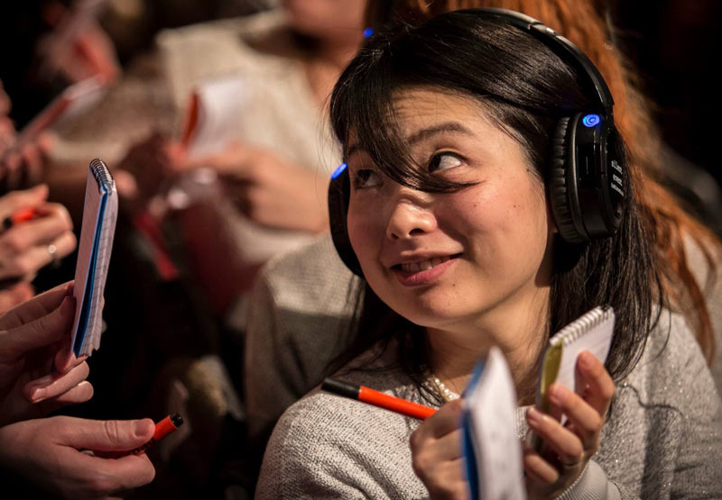 lady with wireless headphones participating in a wireless conference